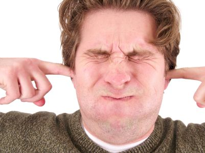 man-with-ears-plugged-eyes-closed-holding-breath